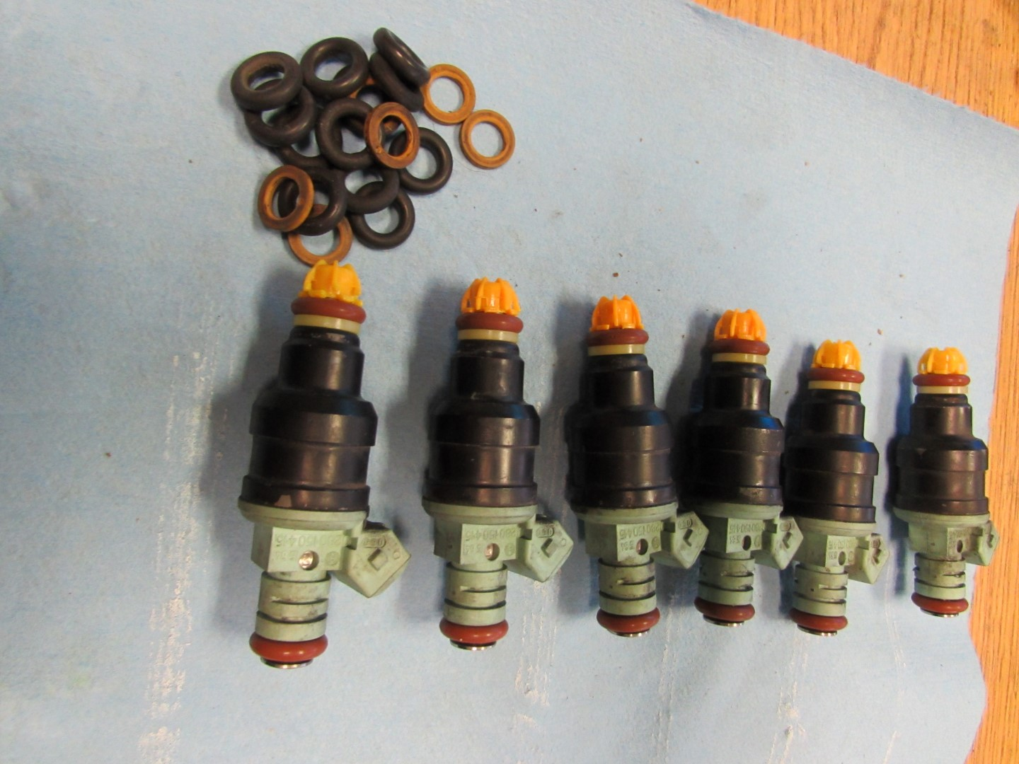 Before re installing the o-rings back into the fuel injector rail, light  grease the o-rings to aid in installation. I sprayed some lubricant on a  towel, ...